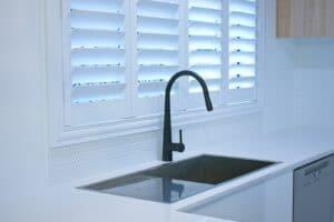 Modern kitchen with plantation shutters window need kitchen sink