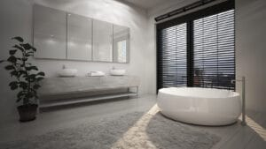 Modern interior of spacious bathroom installed with ThermaStyle shutters and bath tub.