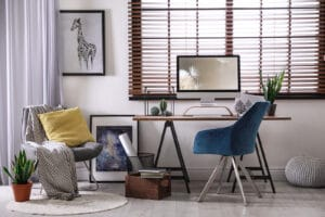 Comforatble and cozy home workplace with horizontal window blinds